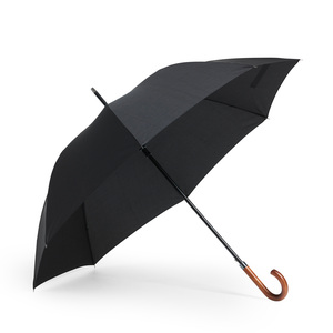 A stylish umbrella with graphite ribs, making it sturdy and resistant to wind. Classic J shaped handle in wood. With its 120 cm in diameter, it is a hybrid between a golf and standard size umbrella. Automatic opening. Eight panels. Shaft, tips and top in black varnished metal.