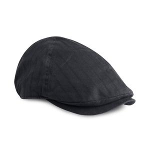 Keps i klassisk golfstil, även så kallad gubbkeps, av randvävt tyg. Förböjd skärm och sluten nacke.