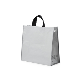 Carrying bag in durable R-PET woven. It is a material that comes from recycled consumer plastic from PET bottles, for example. XL is a bag intended for using at the store and in shopping carts. It has elastic straps with velcro to facilitate packing in the shopping cart and later in your vehicle. A discreet message on the side gussets tells more about the origin of the bag. Labels and hang tags also make it clear to the user that the bag is an environmentally smart choice. Please note: As of now we do not have the opportunity to print on this bag.