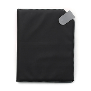 Notepad cover in softly padded PU material with a silky smooth surface. Decorative seams and details such as push-button lock in gray. Inside there are two compartments suitable for business cards, a pen holder, and insert for an A4 pad (included).